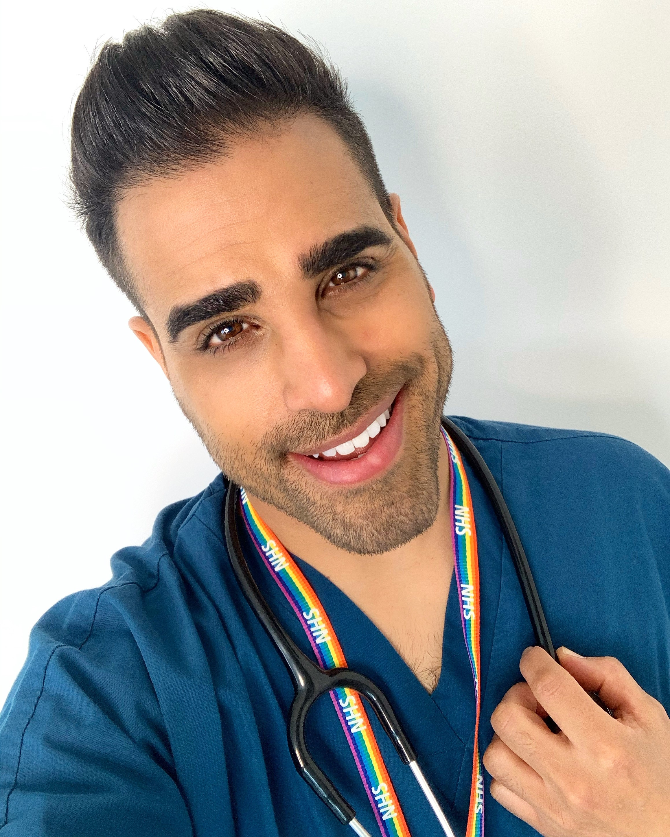 Strictly Come Dancing, Ceebies presenter, Dr Ranj Singh, wearing a blue smock shirt smiling at the camera