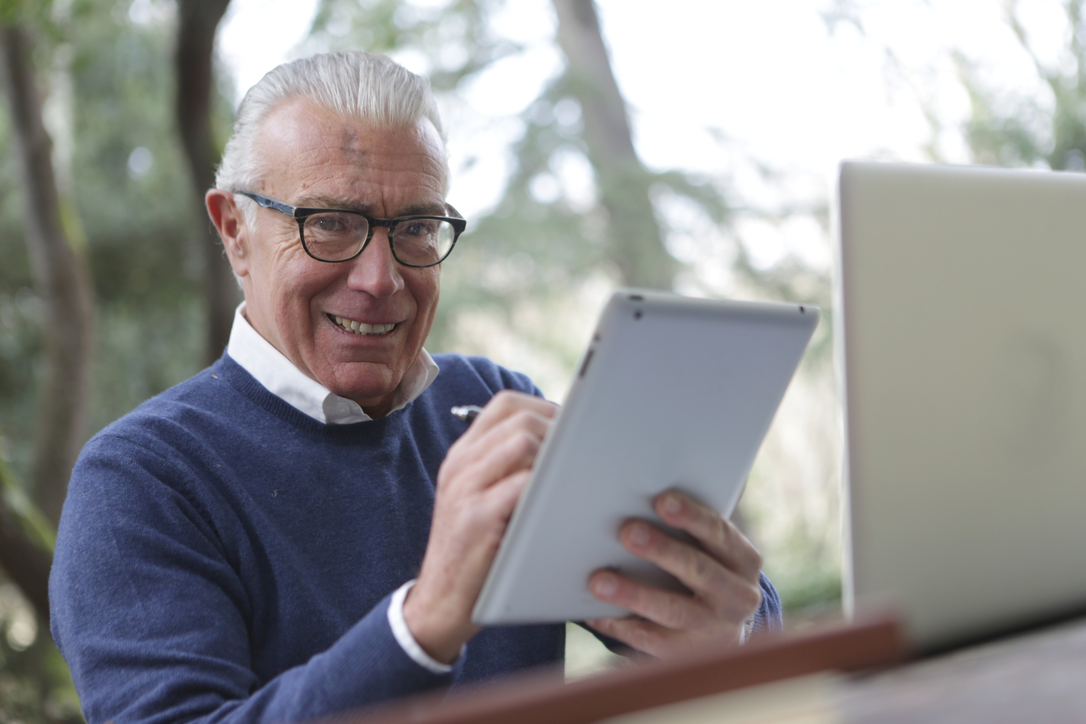 older man using an iPad