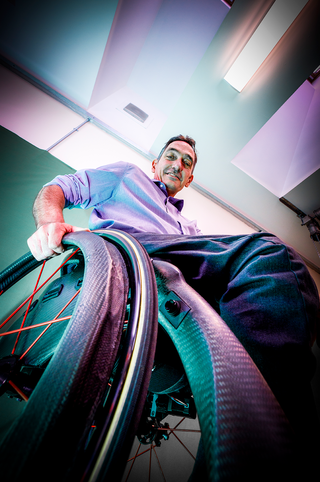 A low angle shot of a white male in a wheelchair