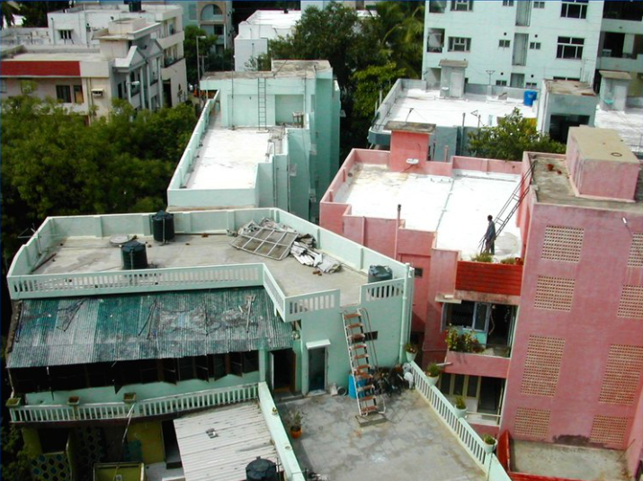aerial shot of different coloured roofs